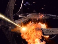 A massive explosion occurs as multiple weapons hit the outer docking ring of the station.
