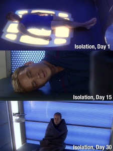 Isolation Log, Day 1: Trip relaxes on the floor of the Decon Chamber. Isolation Log, Day 15: Trip looks a bit exhausted while laying sideways with his head on the bench. Isolation Log, Day 30: Trip is huddled against a wall, wrapped in a blanket.