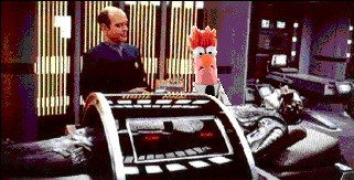 The Doctor and Beaker (from The Muppets) look at a deactivated Borg drone on the biobed in Sickbay.